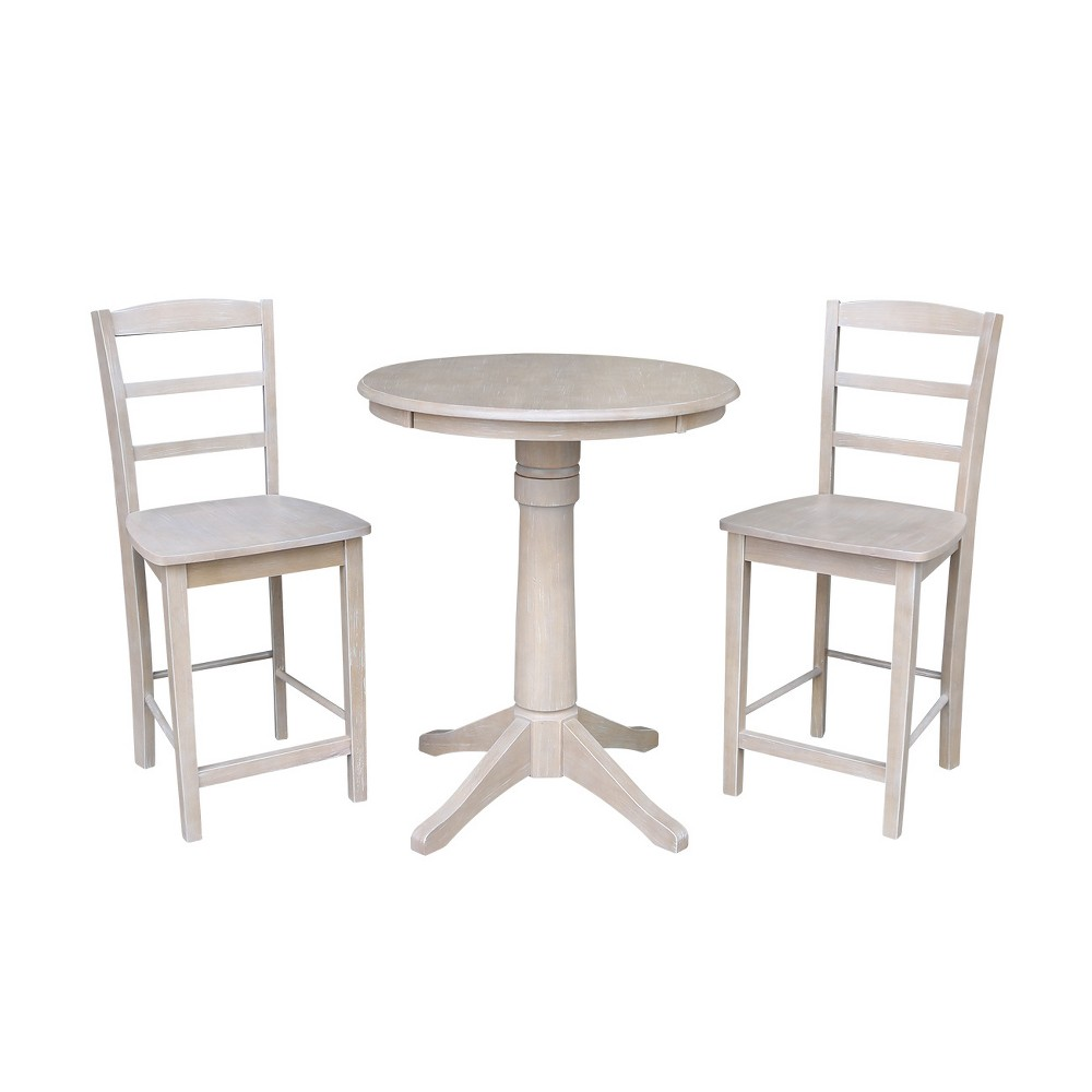 3pc 30x30 Solid Wood Round Pedestal Counter Height Table and 2 Madrid Stools Washed Gray Taupe - International Concepts was $769.99 now $577.49 (25.0% off)