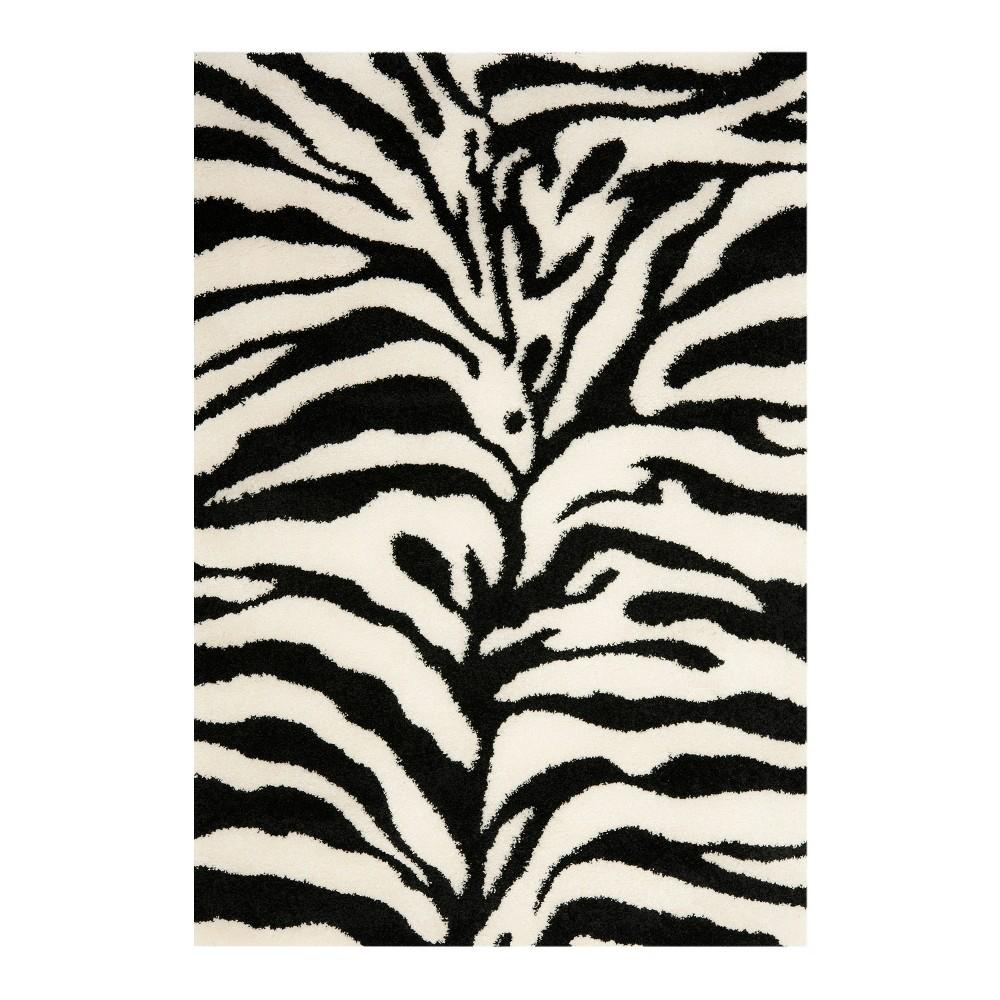 Ivory/Black Animal Print Loomed Area Rug - (8'6x12') - Safavieh, White