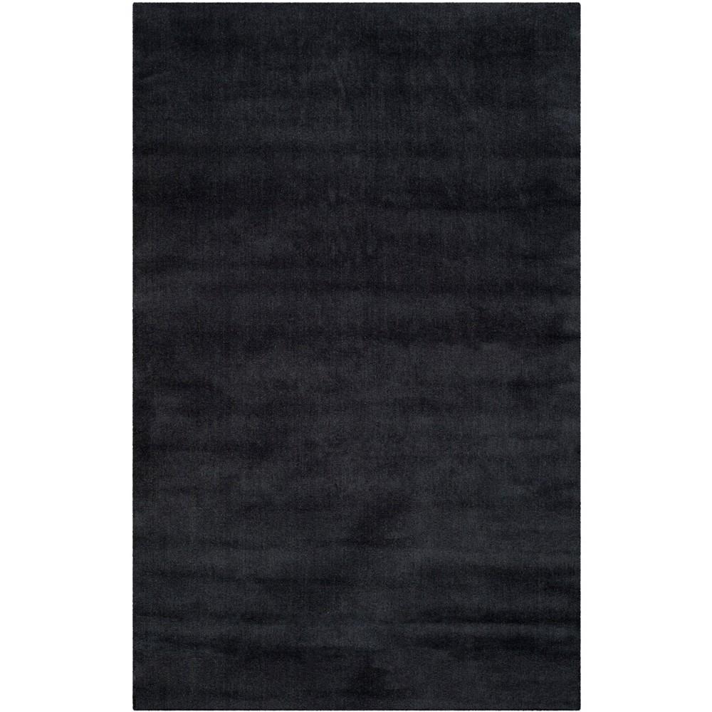 6'X9' Solid Tufted Area Rug Black - Safavieh