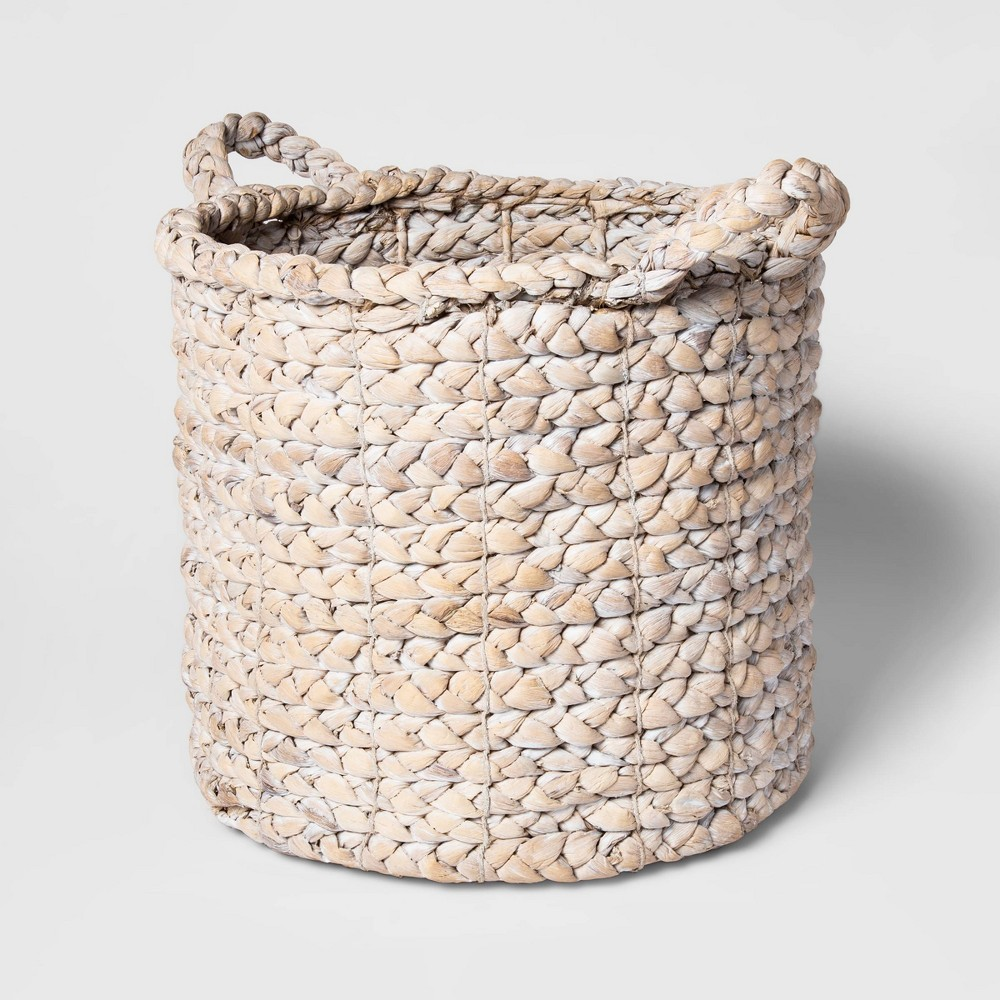 Add a new flair to your storage needs with this White Decorative Basket from Threshold™. This round storage basket in white fits with just about any decor style and gives you a handy spot to stow your household essentials and other knickknacks with ease. Made from durable water hyacinth, this decorative basket ensures long-lasting beauty and brings natural texture to your space. The open top keeps contents easily accessible, while the two looped handles allow you to easily move it from room to room. Gender: unisex.