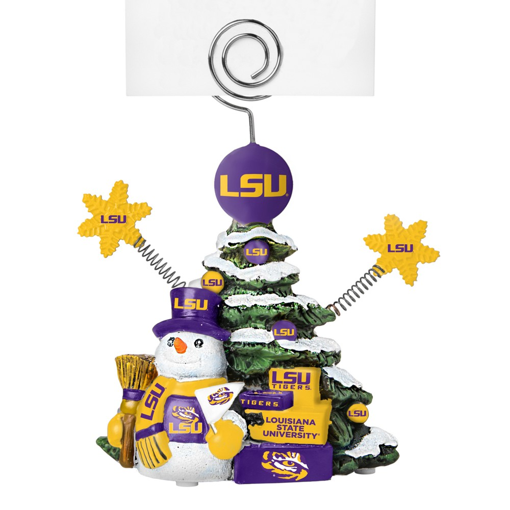 Lsu Tigers Tree Photo Holder, Purple/Gold Beautifully detailed cold cast porcelain tree with snowman and presents. Decorated with colofrul team graphics, this table sop holder is great for holding photos, notes to santa or place cards. Stands 5 tall Color: Purple/gold. Age Group: Adult.