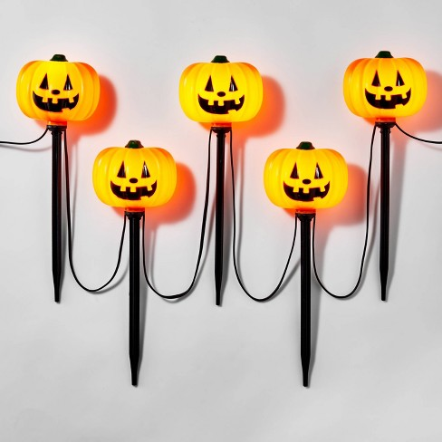 5ct Incandescent Clear Pumpkin Pathway Halloween Light Up Lawn Stakes - Hyde & EEK! Boutique™ - image 1 of 3