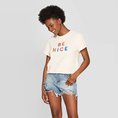 Women's Short Sleeve Be Nice Cropped Graphic T-Shirt - Mighty Fine (Juniors') - Cream - image 1 of 2