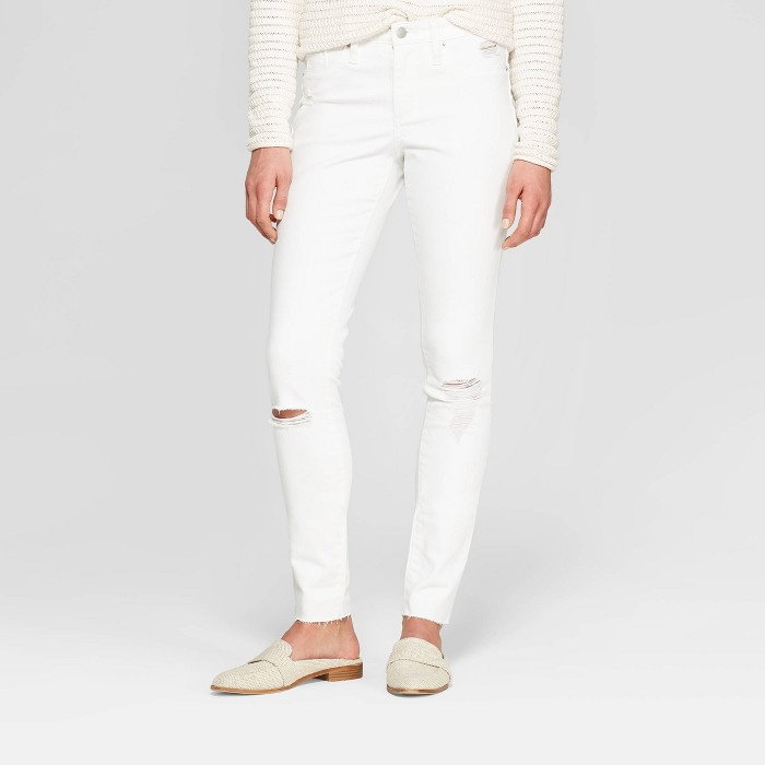 Women's High-Rise Distressed Stain Repel Jeggings - Universal Thread™ White - image 1 of 3