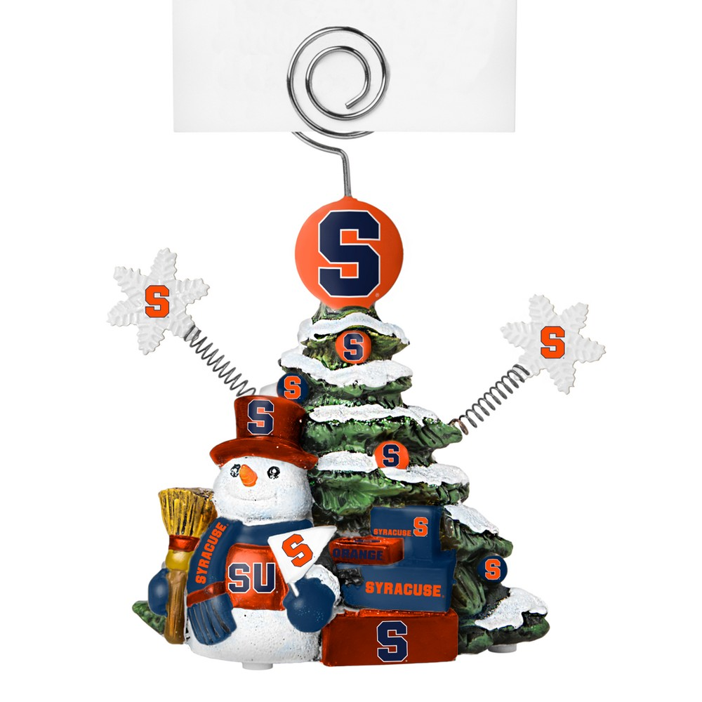 Syracuse Orange Tree Photo Holder Beautifully detailed cold cast porcelain tree with snowman and presents. Decorated with colofrul team graphics, this table sop holder is great for holding photos, notes to santa or place cards. Stands 5 tall Color: Syracuse Orange. Age Group: Adult.