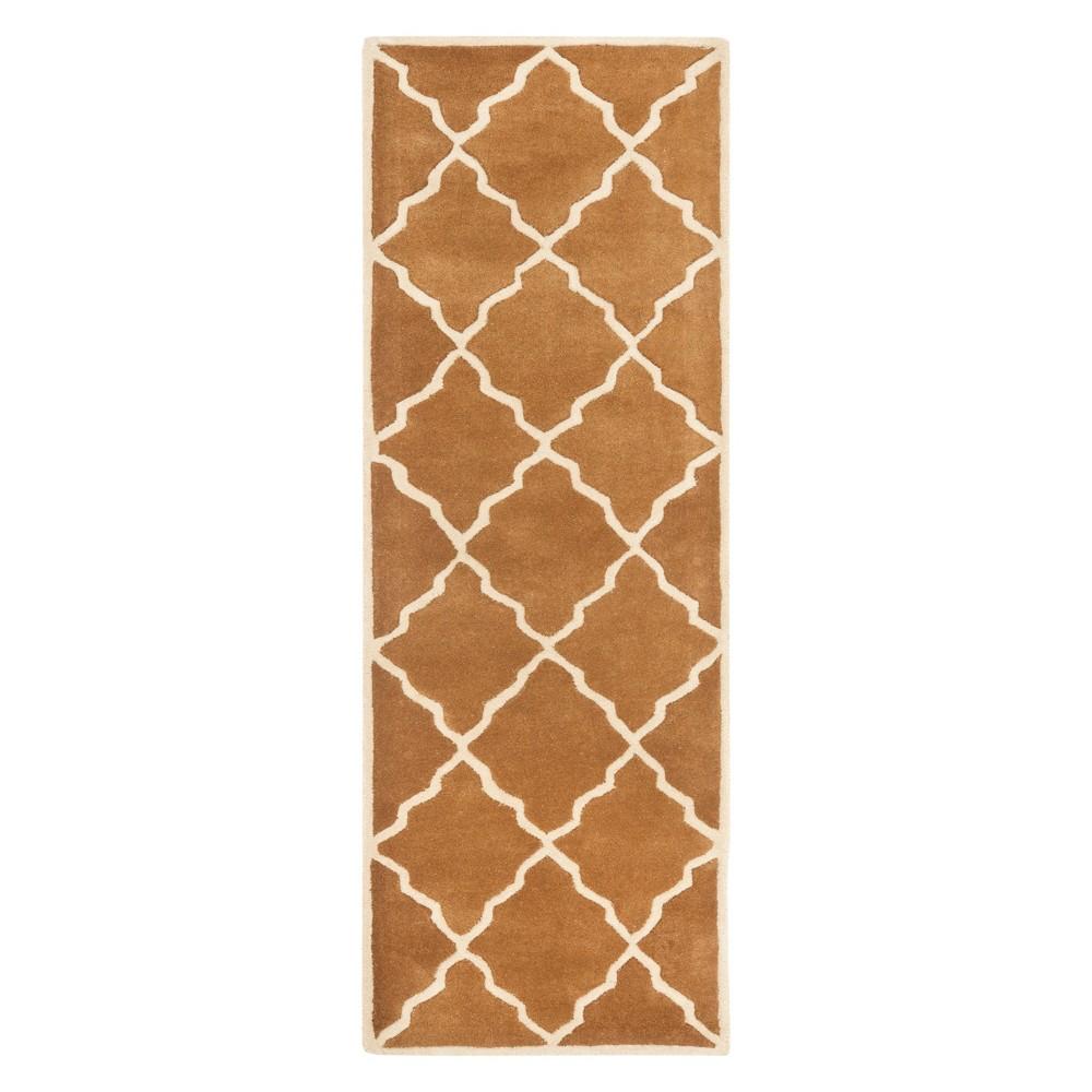 23X9 Quatrefoil Design Tufted Runner Brown - Safavieh Buy