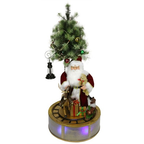 Northlight 4' Animated and Musical Lighted LED Santa Claus with Tree and Rotating Train Christmas Decor - image 1 of 2