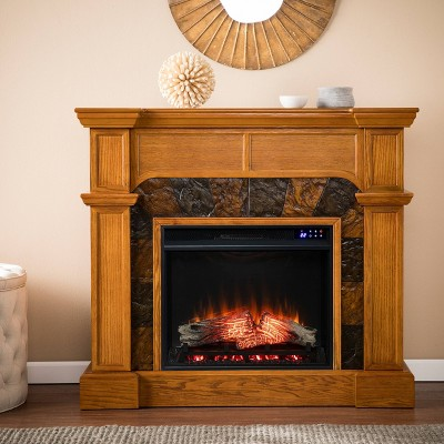 Rosnor Corner Convertible Touch Panel Electric Fireplace with Faux Stone Surround Mission Oak - Aiden Lane