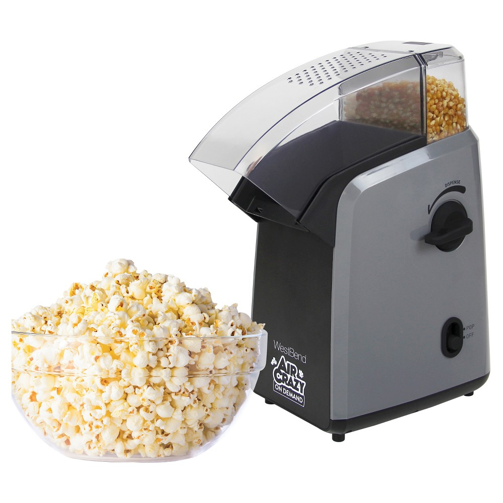 West Bend Air Crazy Popcorn on Demand Hot Air Popcorn Machine, Black The West Bend Air Crazy(TM) Popcorn On Demand popcorn machine offers a fun, fast and efficient way to make healthy air-popped corn at home. It stores popcorn kernels in a special compartment ready to dispense the perfect portion right before popping. Just turn the dispensing lever to your desired portion of popcorn, then press the button to start popping. The West Bend Air Crazy(TM) Popcorn On Demand hot-air popcorn machine stores, measures and pops your perfect portion of popcorn. Choose your portion size by turning the dispensing lever up to four times. The unit dispenses one portion per turn (up to four servings). Popper heats quickly to produce light, crispy kernels—all without a drop of oil. Smart design minimizes unpopped kernels and directs popcorn into the bowl. Color: Black.