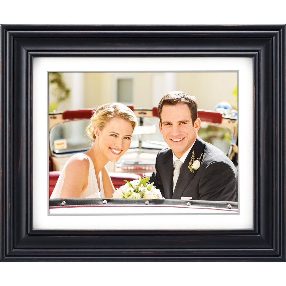 Polaroid 12 Digital Photo Frame - Distressed Black Wood Frame with Mat Keep your priceless digital photos on display, not trapped in the cloud, with the Polaroid Pdf-1250W 12 Digital Picture Frame. Now you can experience your memories in vivid digital clarity, while customizing the rotation and transition effects for your slideshows. With its classic wood frame and mat border, the Polaroid Pdf-1250W 12  Digital Picture Frame will fit right in with your other frames and décor. Don't let this frame's large, high resolution (1024 x 768) Led display fool you - this Polaroid photo frame is not only clear and bright, it's also energy efficient and can be programmed to turn on/off at the times you choose. With the multi-format card reader, compatible with SD, Sdhc and Mmc memory cards, simply insert your SD/Sdhc/Mmc memory card or Usb 2.0 flash drive into the Polaroid Pdf-1250W 12  Digital Picture Frame and a slideshow automatically starts in your home, your office, or anywhere you want them to shine. Color: Black.