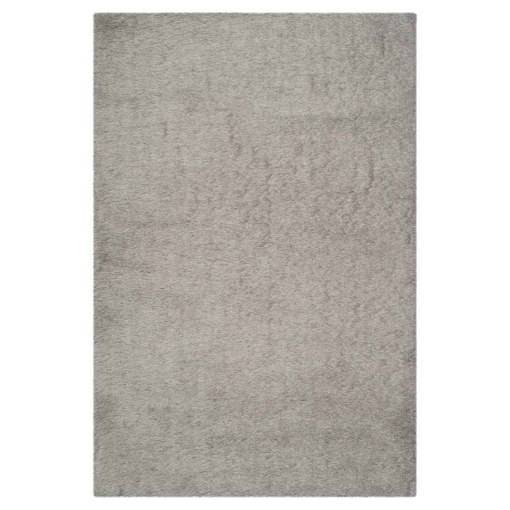 Silver Solid Tufted Area Rug - (5'x7') - Safavieh