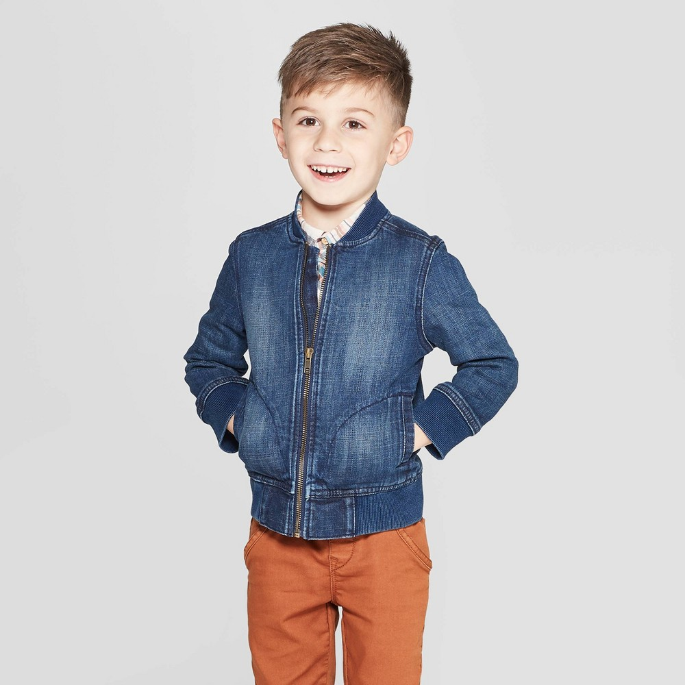 Genuine Kids from OshKosh Toddler Boys' Denim Bomber Jacket - Dark Wash 18M, Blue Cute style and cool comfort are the mainstays of this simply adorable Denim Bomber Jacket from Genuine Kids from OshKosh. Crafted from soft cotton with a hint of spandex for stretch and flexibility, this blue denim bomber jacket makes the perfect addition to his everyday casualwear. This long-sleeve jacket comes with a full front zipper for easy off and on, while the ribbed cuffs and hem keep him all snug and toasty. The distressed accents at front and side patch pockets complete the look. Pair with a comfy jeans-and-tee combo and cool sneakers for cute appeal. Size: 18M. Gender: Male. Age Group: Toddler. Pattern: Solid.