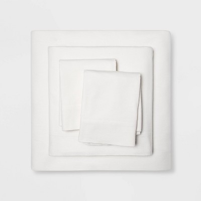 King Holiday Solid Flannel Sheet Set Cream - Wondershop™