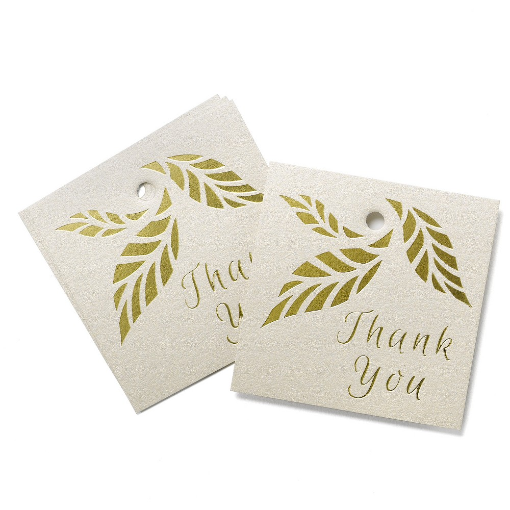 25ct Gold Wedding Favor Tags Square gold shimmer favor tags with gold foil stamp and hole for threading ribbon. Ribbon not included. Pre packaged set of 25. Pattern: Letters.