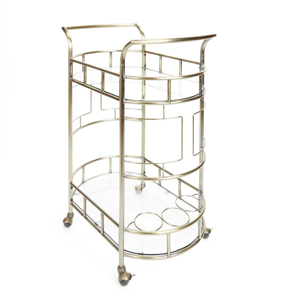 The Sinclair 2-Tier Serving Cart by Silverwood is the perfect way to serve your party guests in style. This tasteful, transitional style serving cart features rolling casters and comes in three stunning metal finishes. The warm metal finishes paired with classic glass tier bases make this cart a uniquely versatile addition to your home or office space. The Sinclair boasts a sturdy, yet open design that creates easy storage for bottles, glasses, or utensils of any height and size. This cart also features 3 built-in wine bottle holders for safe and easy transport. Color: Antique Gold.