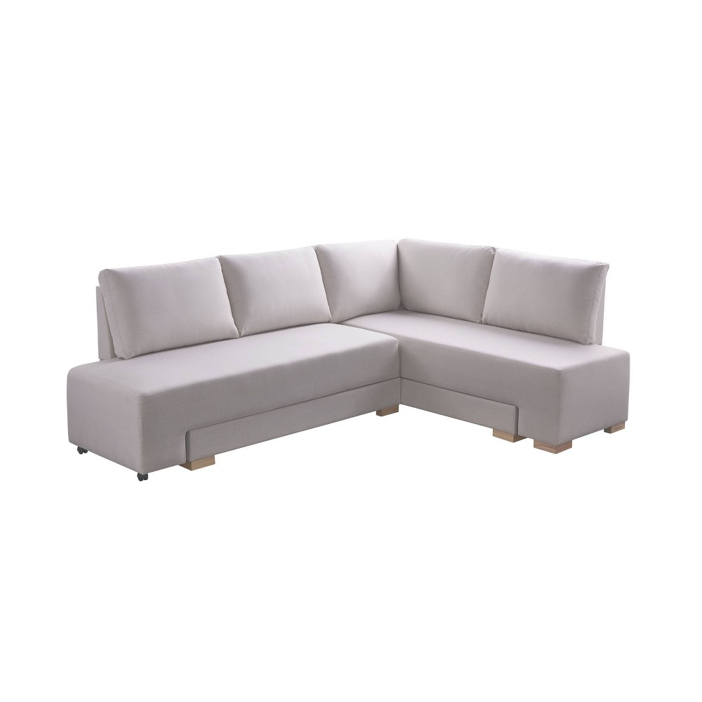 Cream Fabric Sectional Convertible Sleeper has a solid wood frame. A robust yet sleek look is sophisticated. This armless design and natural block feet add to the modern box style. The classy sectional will transform into a durable sleeper for those stay-in-movie-nights with the girls. PVC wheels allow the left sofa to glide into a sleeper. Your gal pals can spend the night in comfort. Foam with pocket coil springs makes for medium firm cushions.