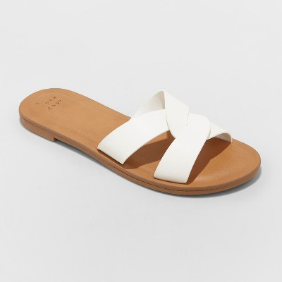view Women's Trina Crossband Slide Sandals - A New Day on target.com. Opens in a new tab.