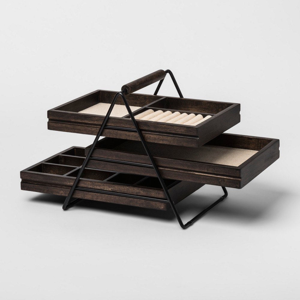 Terrace Jewelry Storage Box Black/Walnut - Umbra, Black Walnut The Mini Stowit Jewelry Storage Box Black Walnut - Umbra is a stylish way of organizing your accessories. This lovely jewelry stand comes with a dark black finish with three racks. Each rack has a specialized compartment for various kinds of jewelry. These detectable racks can be rearranged on the stand anyway you like. Its compact size makes it great for small spaces. Keep it by the dresser or on the bed stand, where it's convenient for you. Gender: Female.