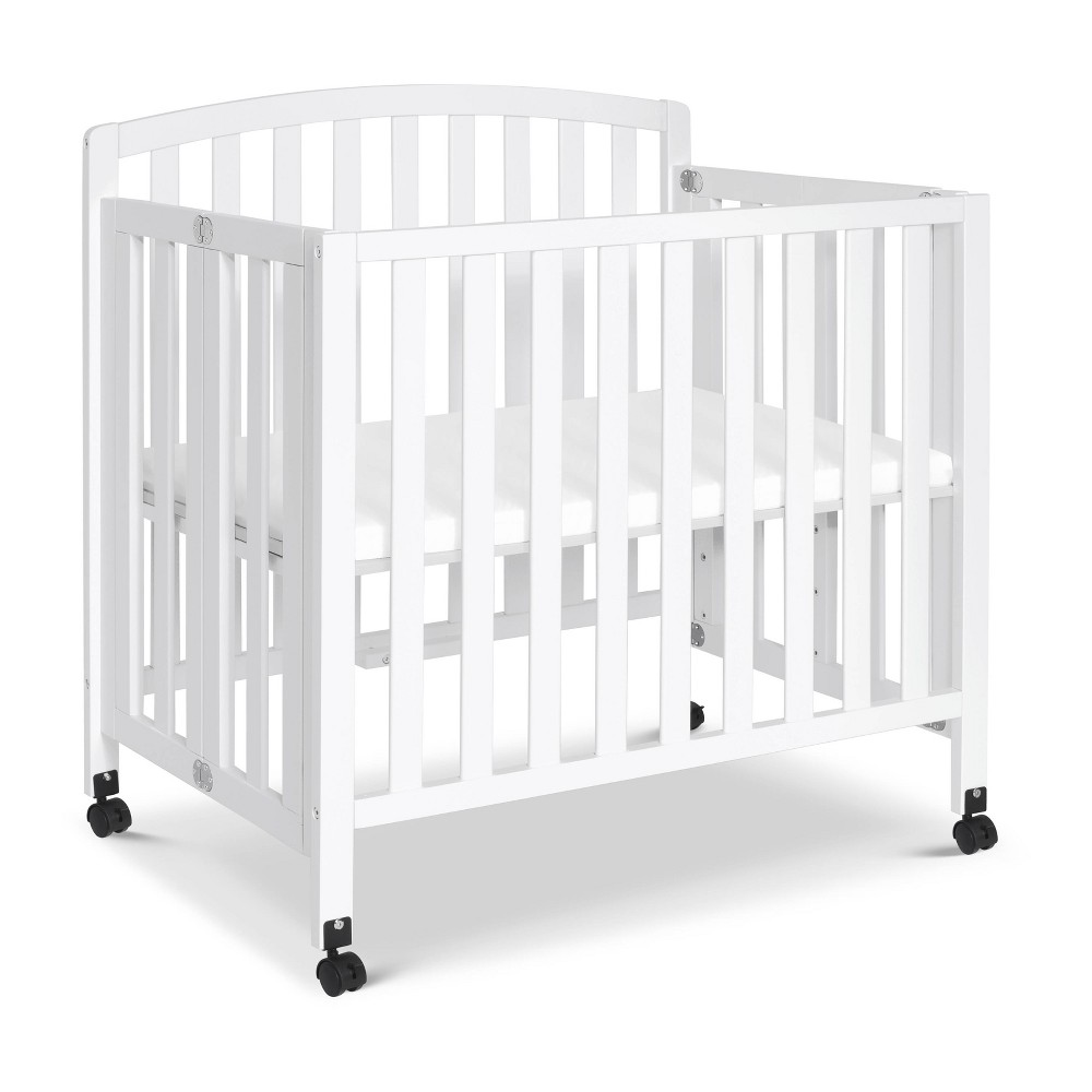 Image of Davinci Dylan Folding Portable 3-In-1 Mini Crib And Twin Bed - White