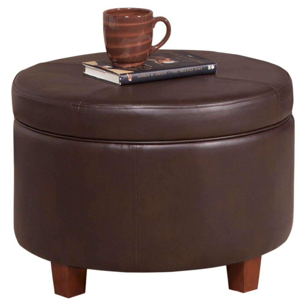 Homepop Large Faux Leather Round Storage Ottoman - Chocolate Brown Our large round storage ottoman offers timeless style in handsome faux leather. Use it in your living room or family room to contain controllers, remotes or toys or place it in your bedroom to store extra pillows or blankets. One faux leather ottoman offers stylish seating and storage ─ two paired together doubles the impact wherever you need it most. Upholstered in vibrant colors with wood legs in a rustic brown finish, our round ottoman has a lift-off lid for quick access to storage within. Available in a range of neutral and on-trend colors; easy to assemble and maintain. Color: Chocolate. Gender: Unisex.
