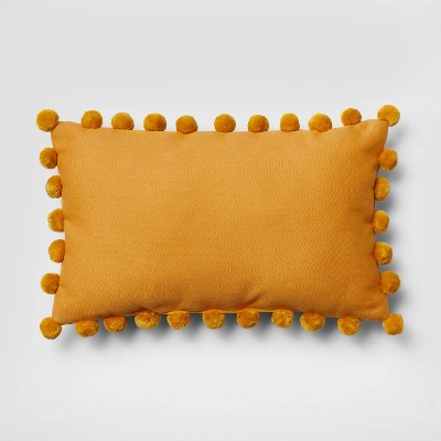 Oblong Pom-Pom Throw Pillow Yellow - Pillowfort™