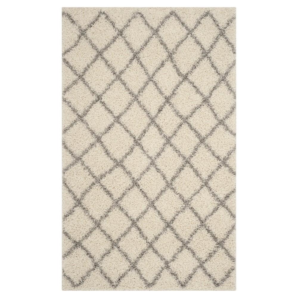 Ivory/Gray Geometric Loomed Area Rug - (5'1