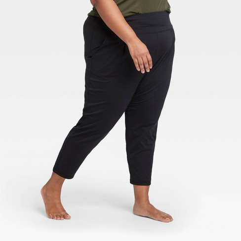 Women's Plus Size Loose Fit Practice Pants - All in Motion™ Black 1X - image 1 of 4