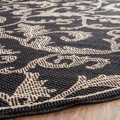 '6'7'' Round Jassy Patio Rug Black/Sand - Safavieh, Size: 6'7'', Black / Brown'