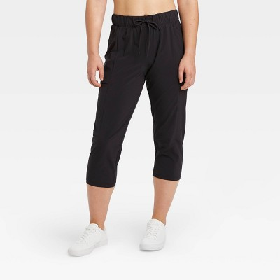 "Women's Mid-Rise Stretch Woven Tapered Leg Capri Leggings 21"" - All in Motion™"