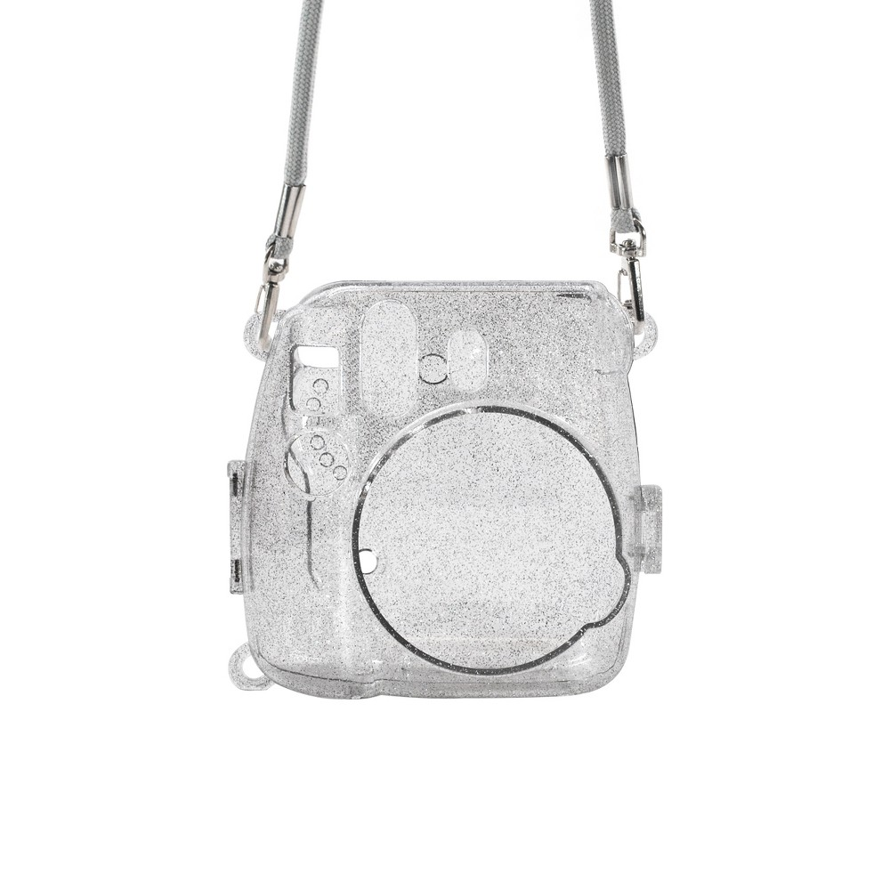 Atny Instax Instant Camera Hard Shell Case with Adjustable Strap - Silver Glitter This clear, glitter injected hardshell Instax camera case protects your camera from dirt and debris without blocking access to controls or covering the lens. Easy to take on and off, it's as stylish as it is sensible. No need to remove the camera from the case to take pictures. Color: Silver.