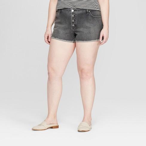 Women's Plus Size Mid-Rise Raw Hem Jean Shorts - Universal Thread™ Black Wash - image 1 of 3