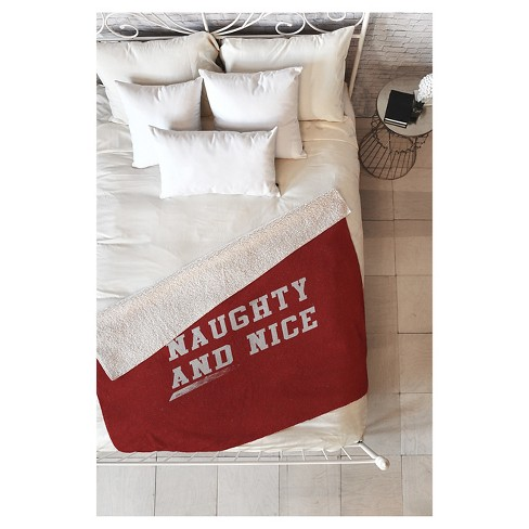 "Red Novelty Leah Flores Naughty And Nice Sherpa Throw Blanket (50""X60"") - Deny Designs® - image 1 of 2"