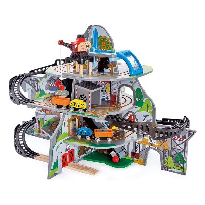 Hape Kids Wooden Railway Cargo Multi Level Train Station Mighty Mountain Mine Toy Play Set with Waterfall Tunnel, Bridge, and Crane