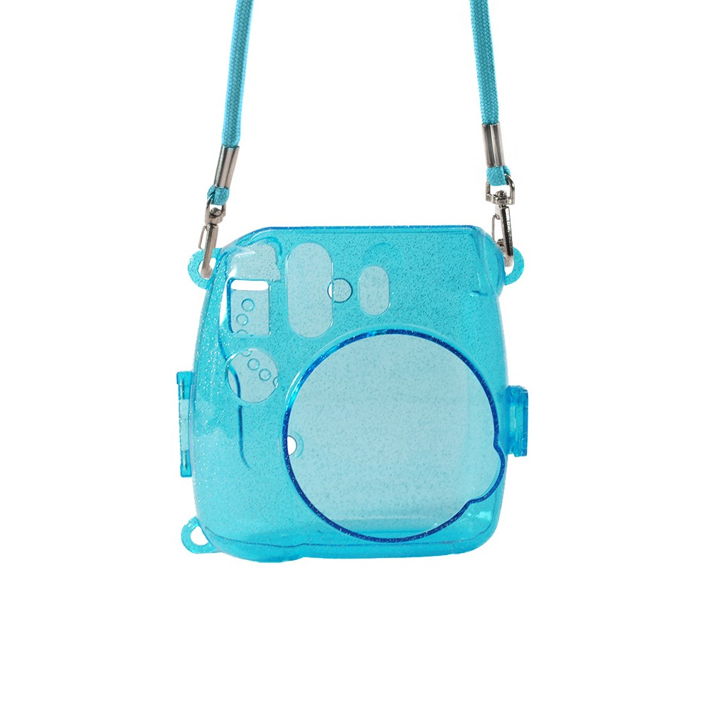 Atny Instax Instant Camera Hard Shell Case with Adjustable Strap - Blue This light blue, glitter injected hardshell Instax camera case protects your camera from dirt and debris without blocking access to controls or covering the lens. Easy to take on and off, it's as stylish as it is sensible. No need to remove the camera from the case to take pictures.