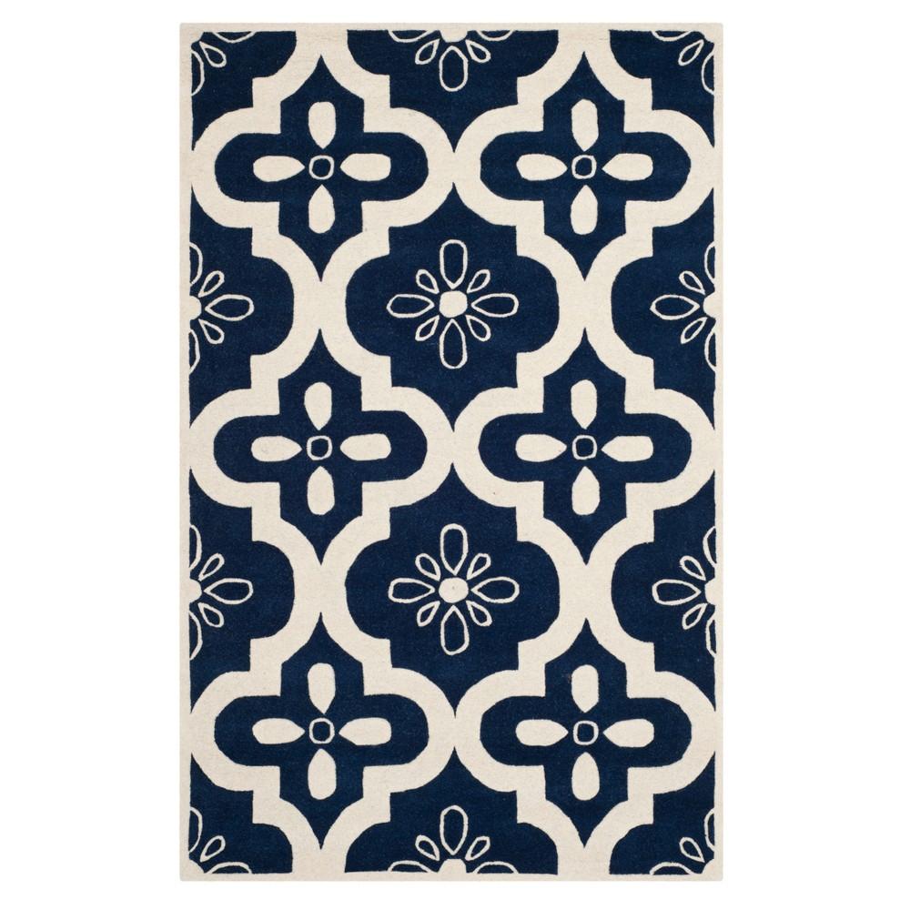 Dark Blue Ivory Quatrefoil Design Tufted Accent Rug 4 X6 Safavieh