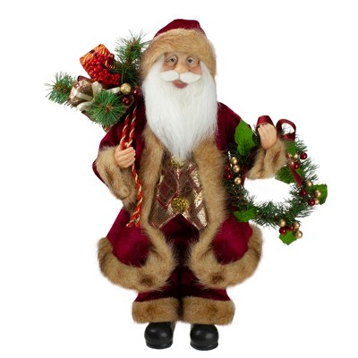 """Northlight 18"""" Red Santa Claus Holding a Wreath and Gift Bag Christmas Figurine"""