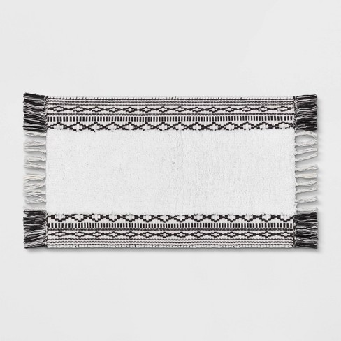 "20""x32"" Striped Fringe Bath Rug Black/White - Threshold™ - image 1 of 4"