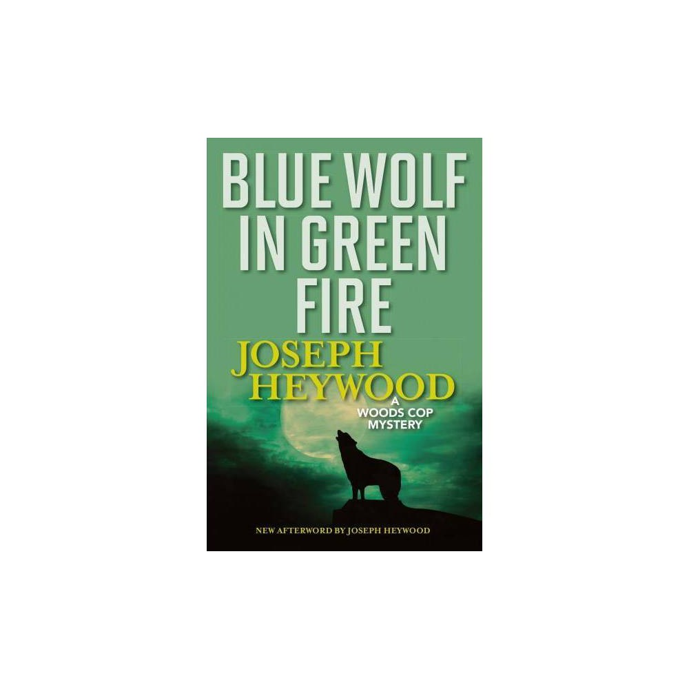Blue Wolf in Green Fire - Reprint (Woods Cop Mysteries) by Joseph Heywood (Paperback)