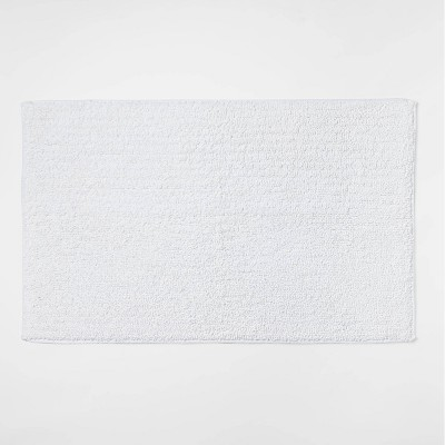 """20""""x34"""" Performance Texture Solid Accent Bath Rug White - Threshold™"""
