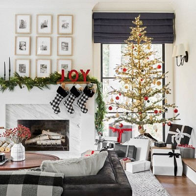 Traditional Holiday Living Room & Mantel Decor with Black & White Accents Collection styled by Emily Henderson