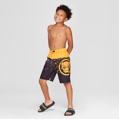 eef69cc110 Boys' Black Panther Gold Swim Trunks - Black. Shop all Marvel