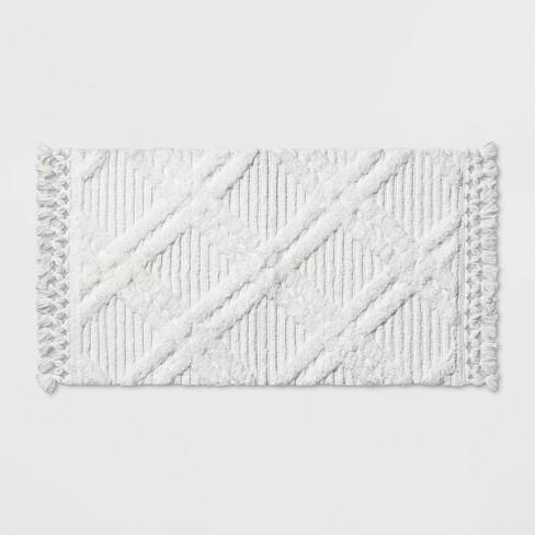 Diamond Embossed Tasseled woven Bath Rug White - Threshold™ - image 1 of 2
