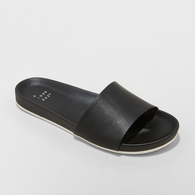 view Women's Aveline Sport Slide Sandals - A New Day Black on target.com. Opens in a new tab.