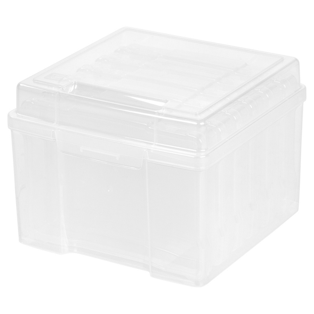 Iris 5  x 7  Photo Storage Box, Clear Store and organize up to 600 photos with this embellishment craft keeper. Keeper includes six 5  x 7  cases to organize and protect any photos and small craft items including stamps or stickers. The durable handle makes it easy to transport your photos or craft items wherever you go. Color: Clear.