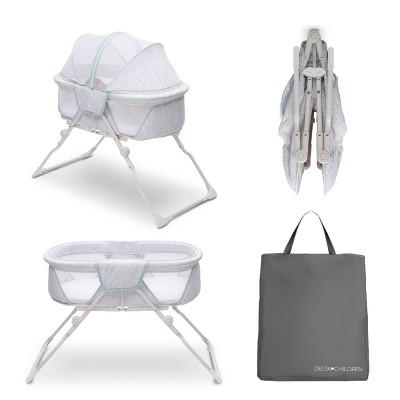 Delta Children EZ Fold Ultra Compact Travel Bassinet - Gray/Aqua