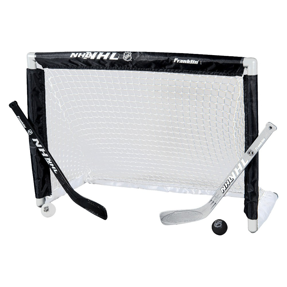 Franklin Sports NHL Mini Hockey Goal Set, Black/Silver Enjoy the rush of blasting slap shots and making epic saves with this NHL Mini Hockey Goal Set from Franklin. This toy hockey set comes with two miniature hockey sticks, a small sized goal and two balls that serves as pucks for safe play. Every item in this set features an NHL logo or design, making it the perfect gift for a hockey fan who likes to test their own skills while having fun. Color: Black/Silver.