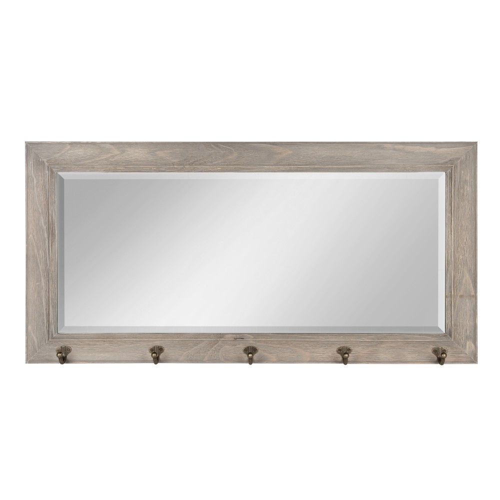 Decorate your home in traditional style with this classic framed pub mirror. Hang this functional mirror in your kitchen, mudroom, or over your entryway bench to organize and hang coats, hats, scarves, dog leashes, or house keys. This framed mirror will look also look handsome featured behind your home bar for a classic pub look. The beveled mirror surface has a one inch bevel. Metal d-ring hangers are attached to the back for easy wall display. Pattern: Solid.
