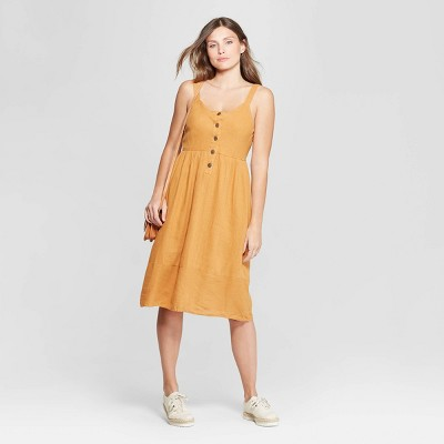 view Women's Sleeveless V-Neck Button Front Midi Dress - Universal Thread Gold on target.com. Opens in a new tab.