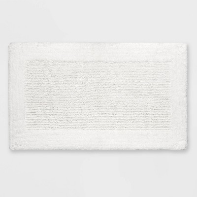 "23""x38"" Performance Textured Bath Rug White - Threshold™"