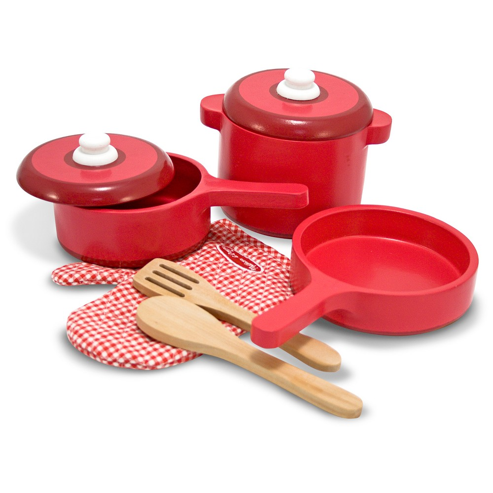 Melissa & Doug Deluxe Wooden Kitchen Accessory Set - Pots & Pans (8pc) Get ready to cook up something yummy! This 8pc wooden cook's set includes a frying pan, stockpot and saucepan with lids, spoon, slotted spatula, and an oven mitt. It's everything you need to equip a serious chef's kitchen. Gender: Unisex.